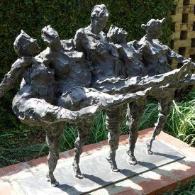 Sculpture of five women dancing arm-in-arm